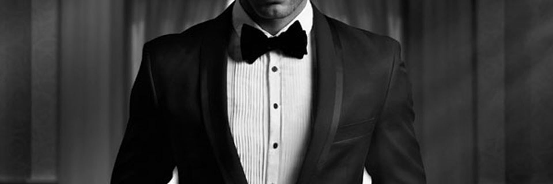 Archer - black and white image of a man in a tuxedo
