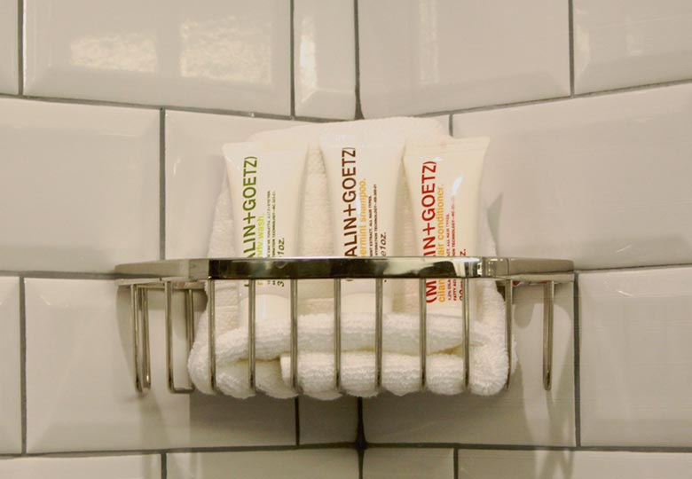 Malin and Goetz products on the shower wall