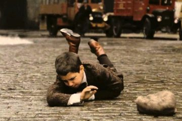 Film Festival image of a boy falling on the street
