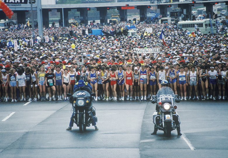 Starting line for the New York City Marathon with two motorcycles upfront
