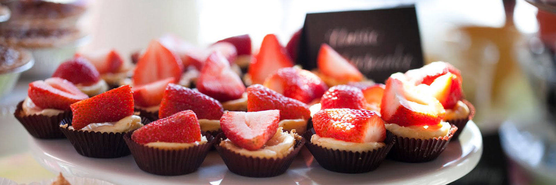 Cupcakes with fresh strawberries on top