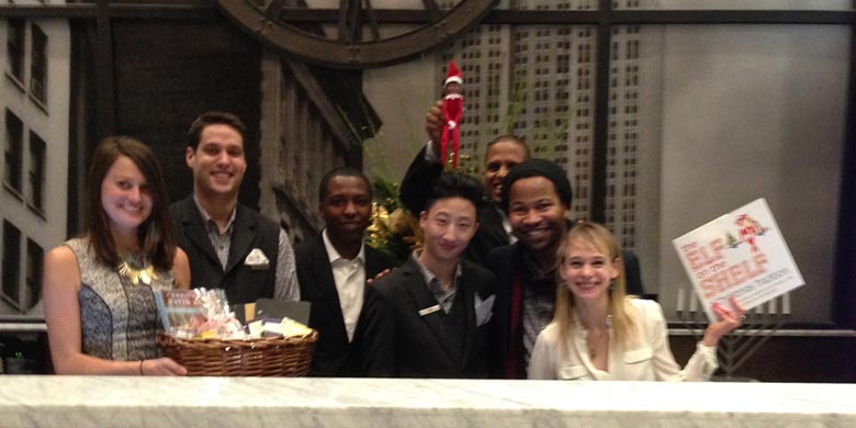 Archer Hotel NY and Archie, their resident Elf on a Shelf with Archer Hotel Staff