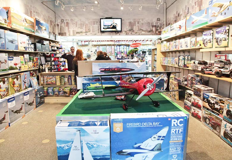 Pilotage shop with toy airplanes and cars