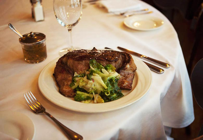 Keens Steakhouse steak with greens