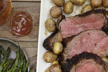 Charlie Palmer Steaks florentine roasted strip loin with new potatoes and asparagus