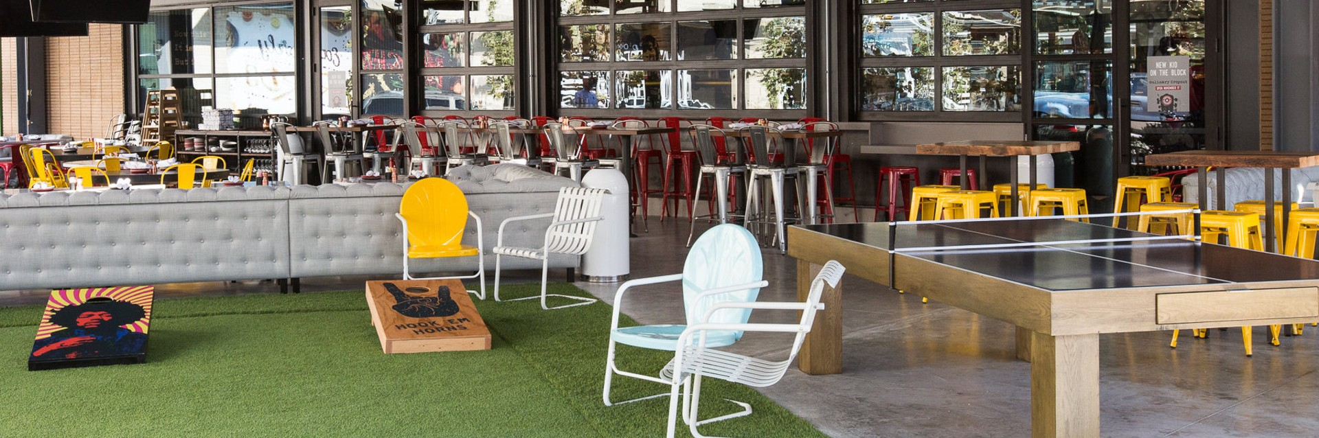 The large patio space and yard games featured at Culinary Dropout in the Domain NORTHSIDE