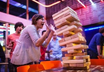Play giant jenga at Kung Fu Saloon