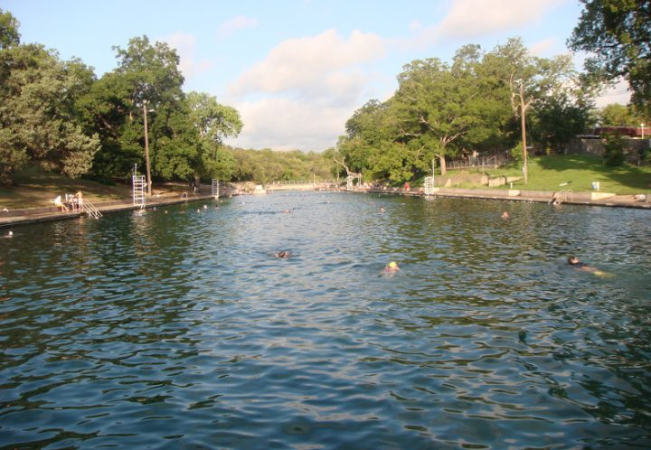Take a free dip at the Barton Springs Pool before 8 am and after 8pm