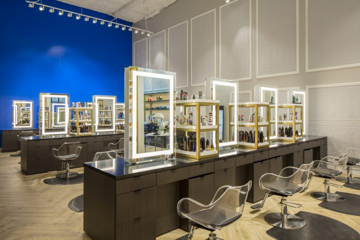 Salon stations with lit mirrors