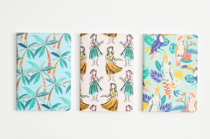 Summery notebooks with palm trees, hula girls and tropical birds