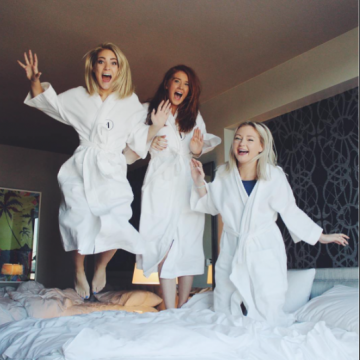Archer girls jumping on bed