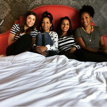 Four girls sit in Archer Guest Room
