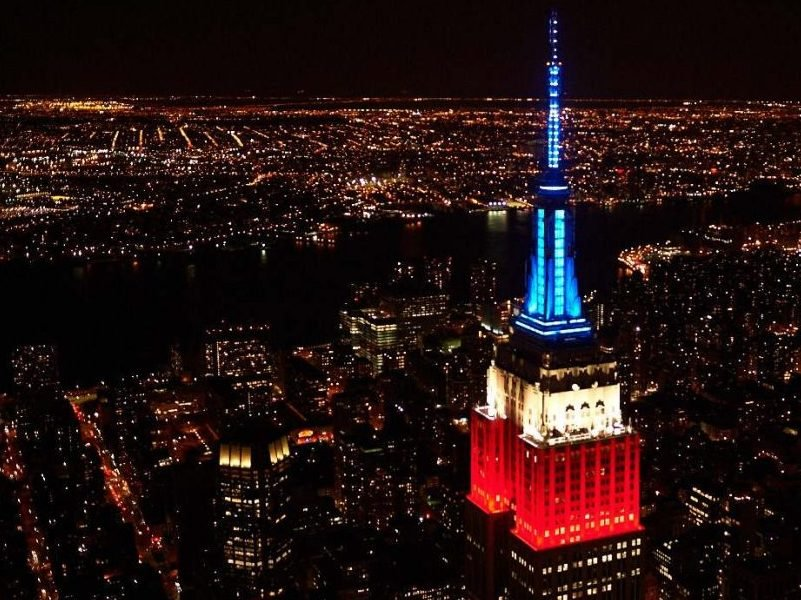 The Empire State Building with red, white and blue lighting