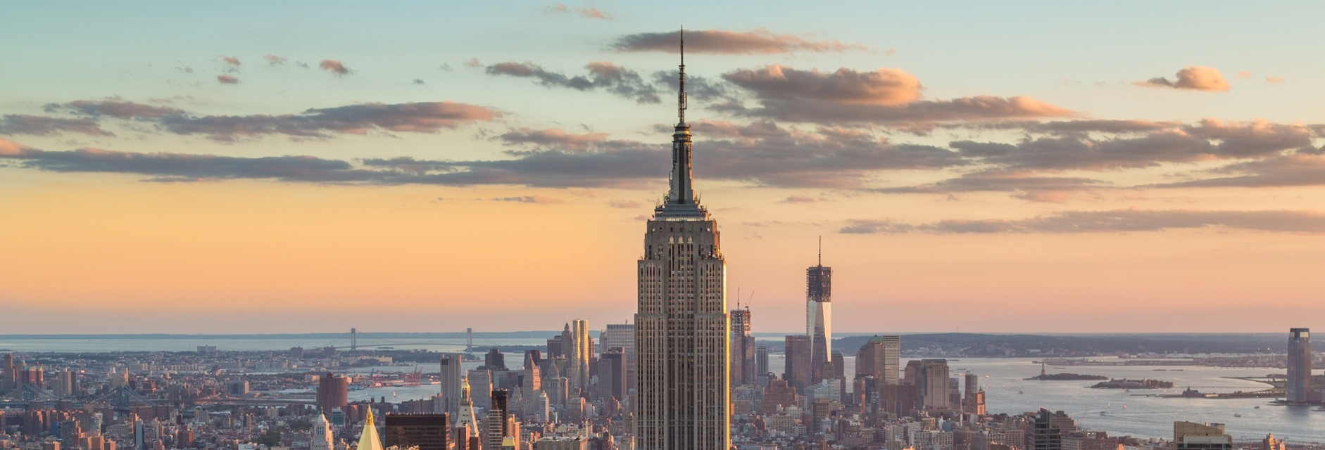 Sunset aerial view of the top of the Empire State Building and cityscape — Photo courtesy of Sam valadi [CC BY 2.0 (https://creativecommons.org/licenses/by/2.0)]