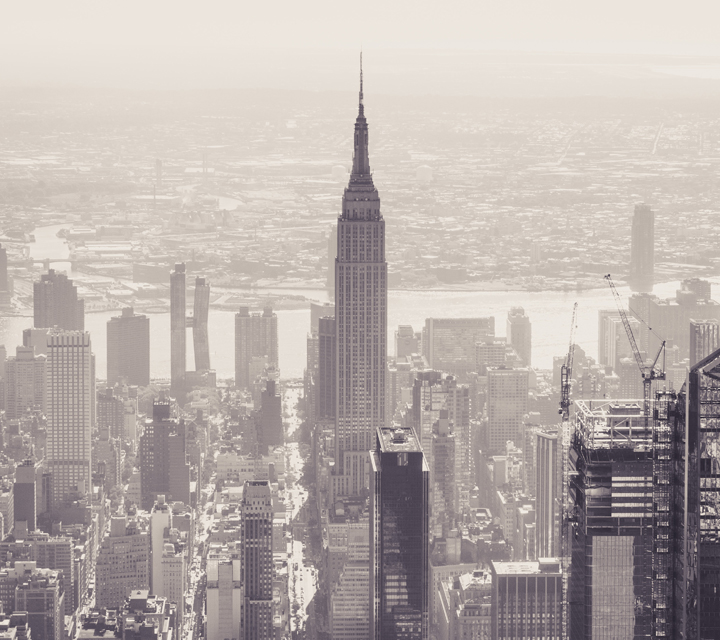 Black and white aerial photo of the Empires State Building on a hazy day — Photo courtesy of Samuel Walker from Pexels