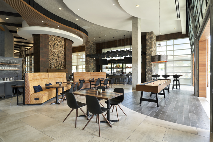Archer's Kitchen + Bar with tables and chairs, booths and shuffleboard