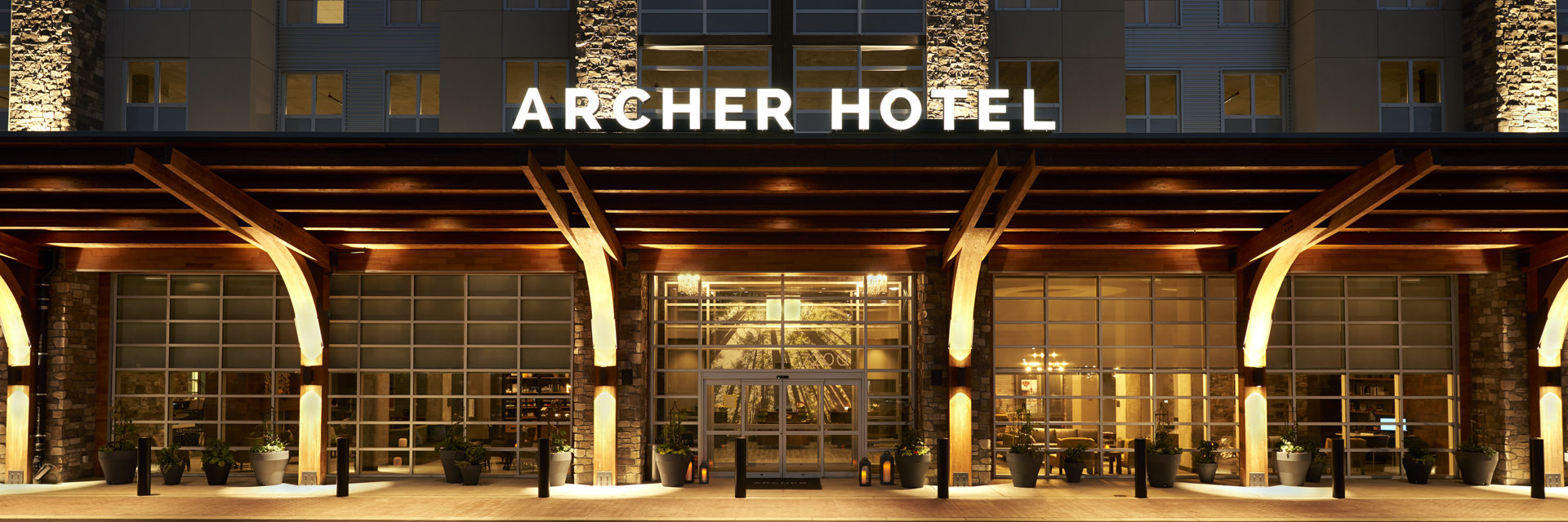 Exterior shot of Archer Hotel Redmond at night, lit up