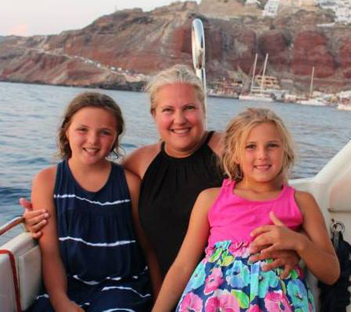 Christine Johnson with daughters on a boat in the water