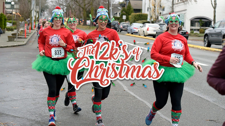 Four women dressed in red shirts and green tutus running in a street