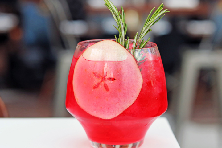 Nochebuena Ponche From SBK — Red cocktail with herb sprig