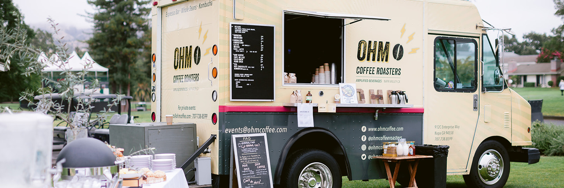 The OHM Coffee Roasters truck parked on a lawn at an event