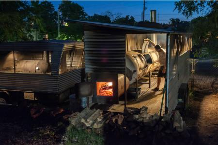 Aaron Franklin Tending Pit, Franklin BBQ, Austin, TX, 2013 — Photograph by Wyatt McSpadden