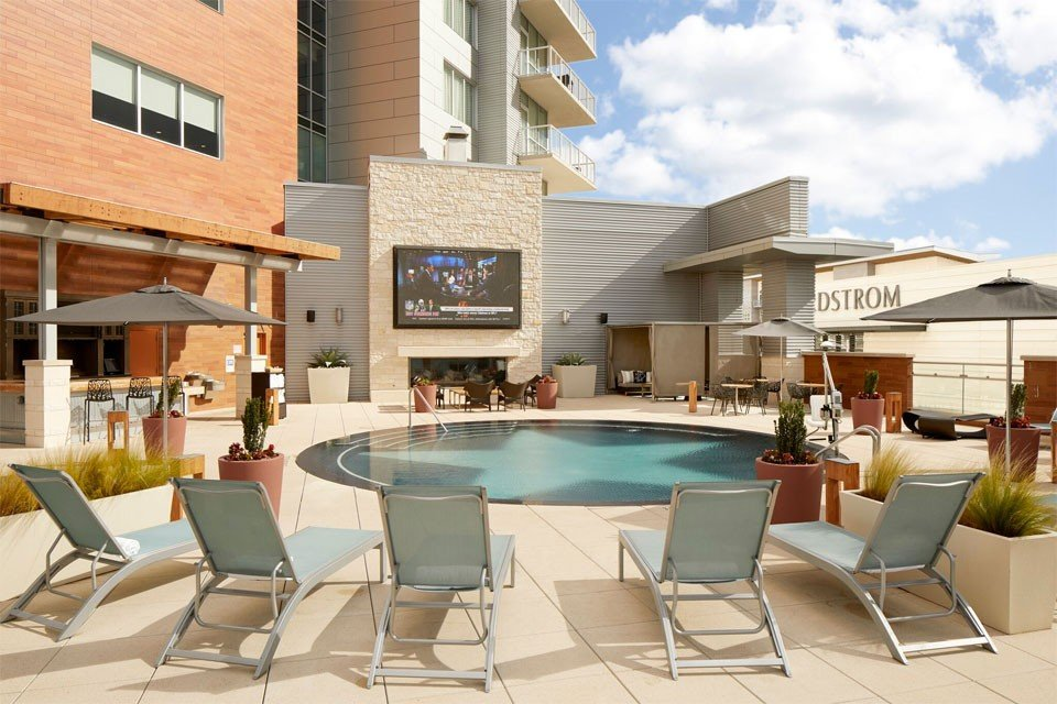 Archer Hotel Austin — pool, lounger chairs, bar and outside TV
