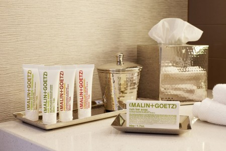 Malin+Goetz luxury bath amenities on a silver tray