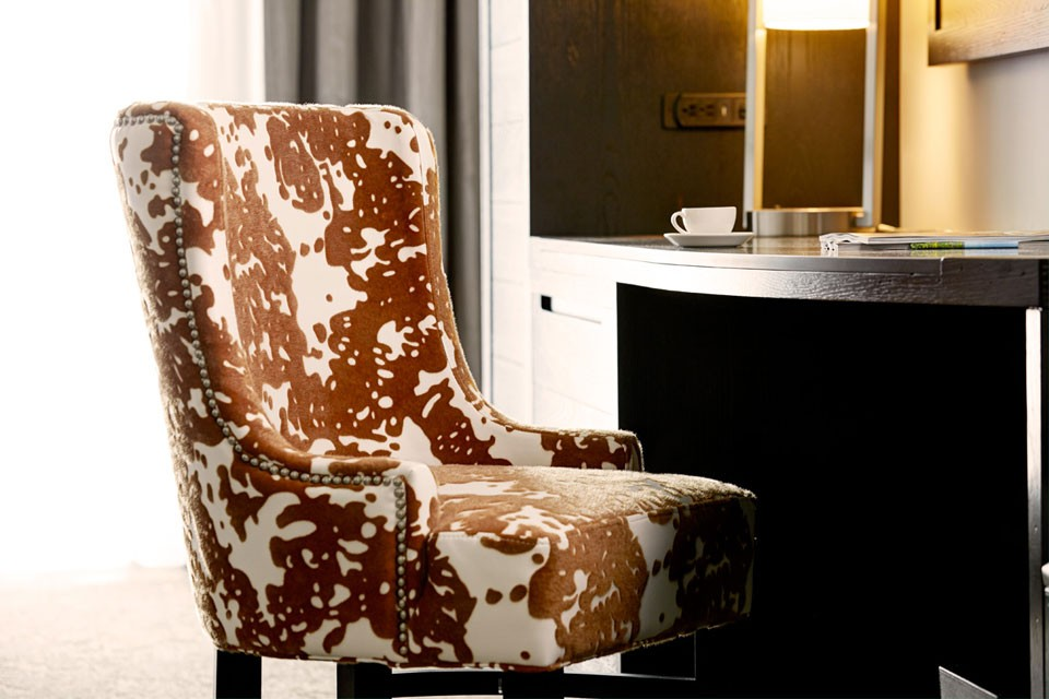 Archer King Suite With Balcony - desk chair with cowhide print