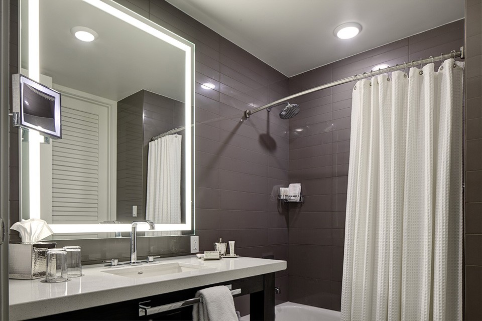 Double King - bathroom vanity and mirror with a tub-shower combo