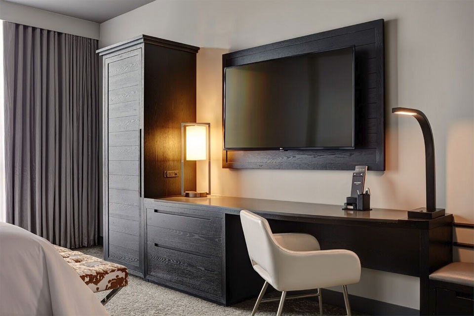 Archer Hotel Austin King Balcony Suite Guest Room — desk and wall-mounted TV