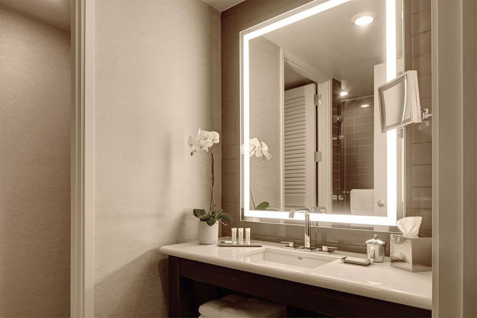 Archer Hotel Austin King Suite Guest Room — vanity and mirror
