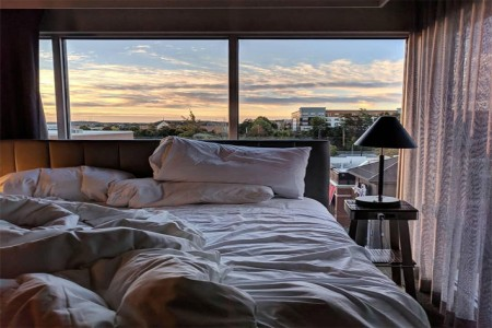 Hotel bedroom with a skyline view