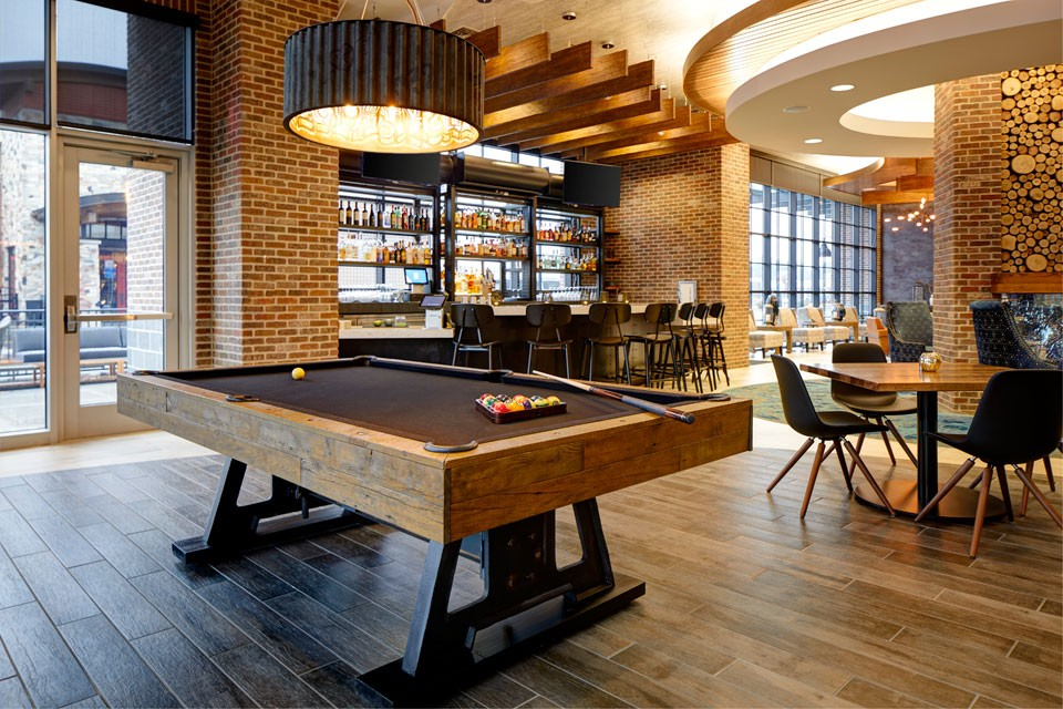 Archer's Kitchen + Bar with industrial pool table