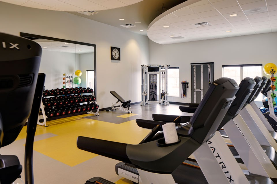 Fitness studio with treadmills and weights