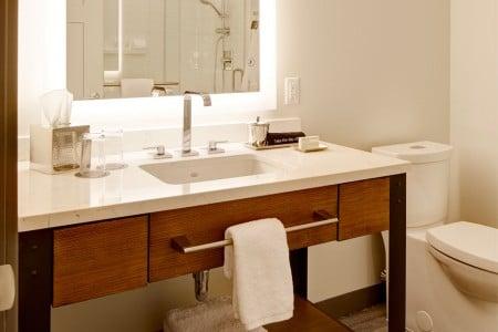 Modern bathroom with weathered iron vanity and mirror