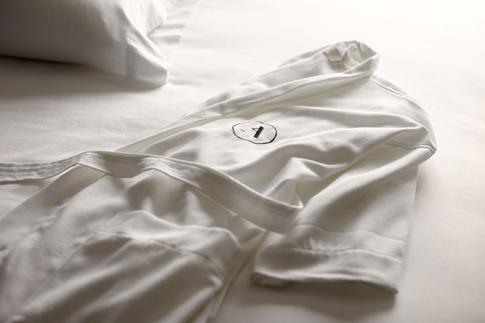 White Frette bathrobe on bed