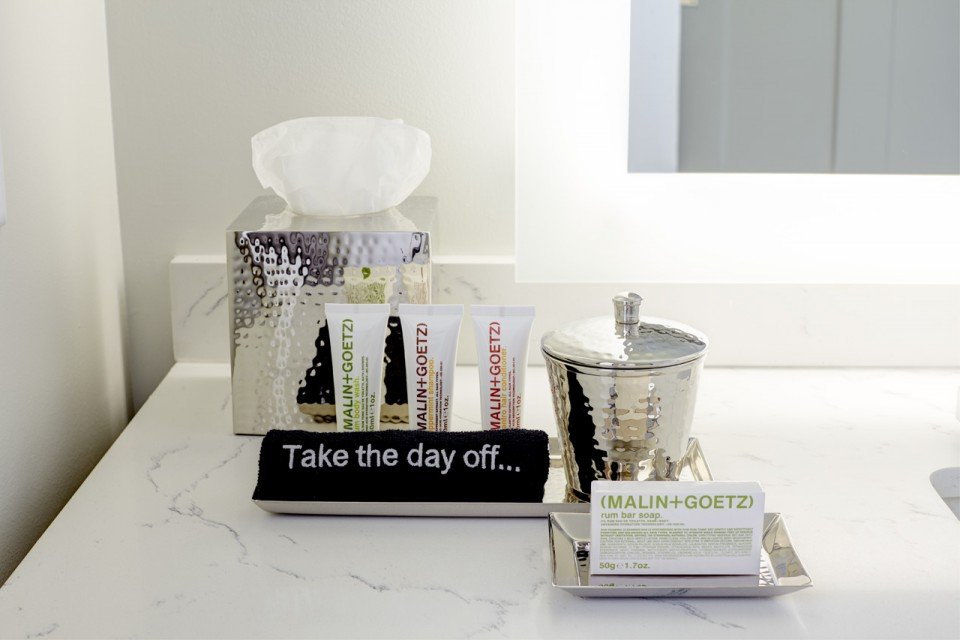Malin+Goetz luxury bath amenities on bathroom vanity