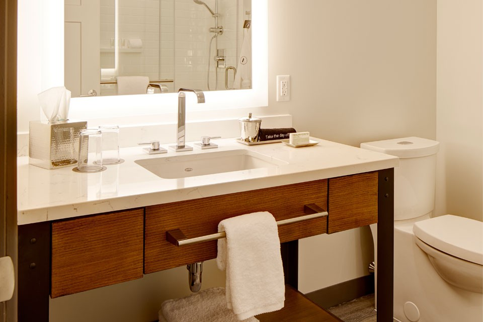 Archer Hotel Burlington Classic King Hearing-Accessible Guest Room - vanity and mirror