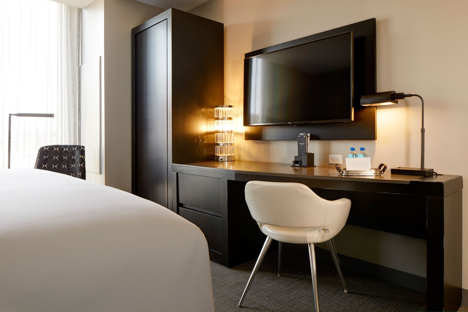 Archer Hotel Burlington Classic King Mobility-Accessible Guest Room With Roll-in Shower - desk and wall-mounted TV