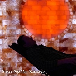 Silhouette of person reclining with an orange background}