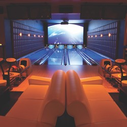 Bowling lanes with lights and comfortable seating at Lucky Strike }