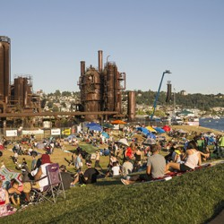 A crowd of people at Gas Works Park, overlooking Lake Union}
