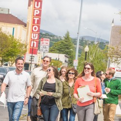 Group tour walking in downtown Napa on a sunny day}