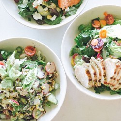 Three bowls with salads}