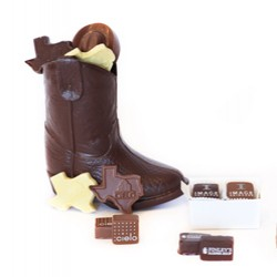 Large chocolate boot with smaller chocolates in and scattered around the boot}
