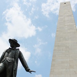 Looking up at Bunker Hill Monument and the statue of Dr. Joseph Warren on a sunny day}