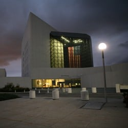 Exterior of the John F. Kennedy Presidential Library and Museum at night}