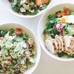 Three bowls with salads