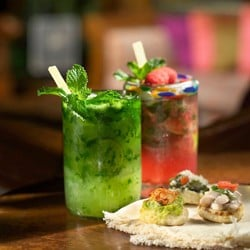 Two crafted cocktails and small bites